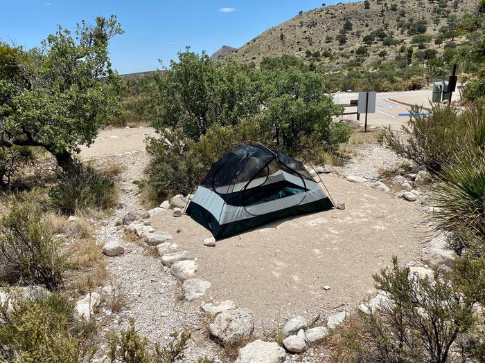 A forth tent pad located in the center of group site #1, displaying a two person tent.  Desert vegetation surrounds the area.  The tent pad is delineated by large rocks.A forth tent pad located in the center of group site #1. Desert vegetation surrounds the tent pad.