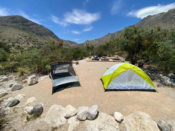 Group site #2 shown from the southern side of site with views of the mountains and Pine Spring Canyon.  The site is displaying 2 two-person tents on the tent pad.