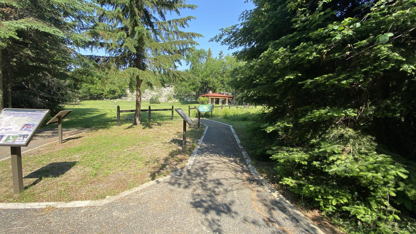 Accessible trail leading past waysides to pavilion.