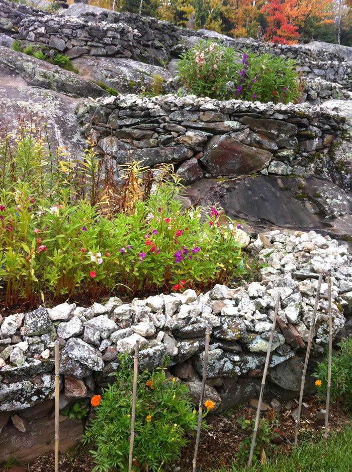"Lower flower beds topped in ""frosting"" rock, comprised of crushed quartz."
