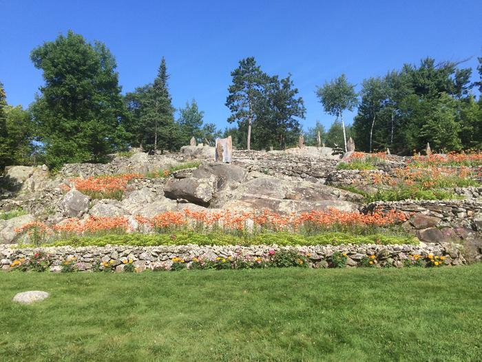 View of restored flower beds in full bloom at Ellsworth Rock Gardens