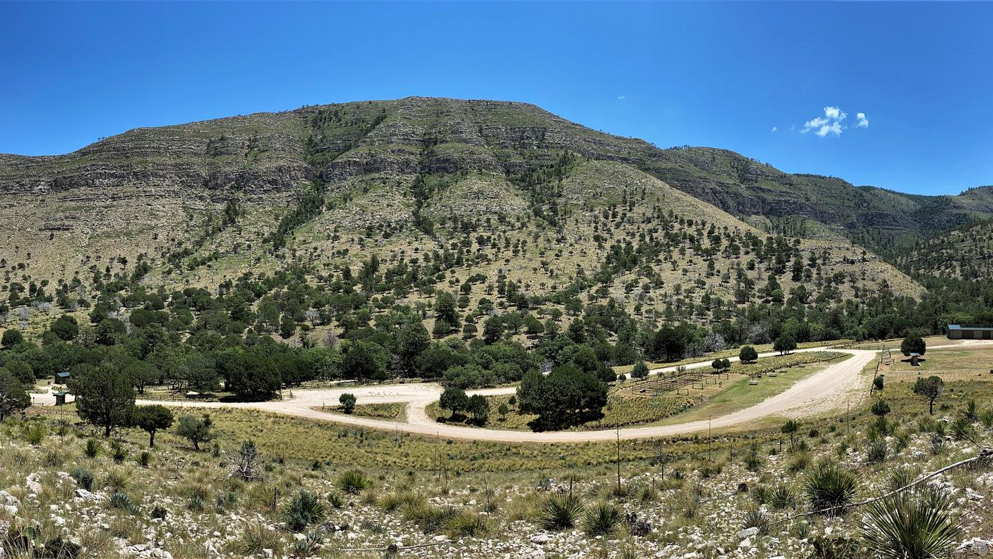 Overview of Dog Canyon campground and loop road with view of mountains in the background.Overview of Dog Canyon campground, loop road and mountain views.
