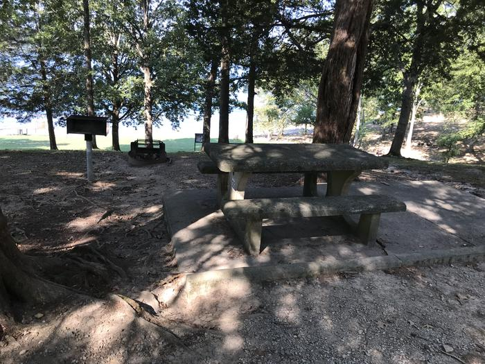 WILLOW GROVE CAMPGROUND SITE #55 CONCRETE TABLE WITH BEACH IN BACKGROUNDWILLOW GROVE CAMPGROUND SITE #55