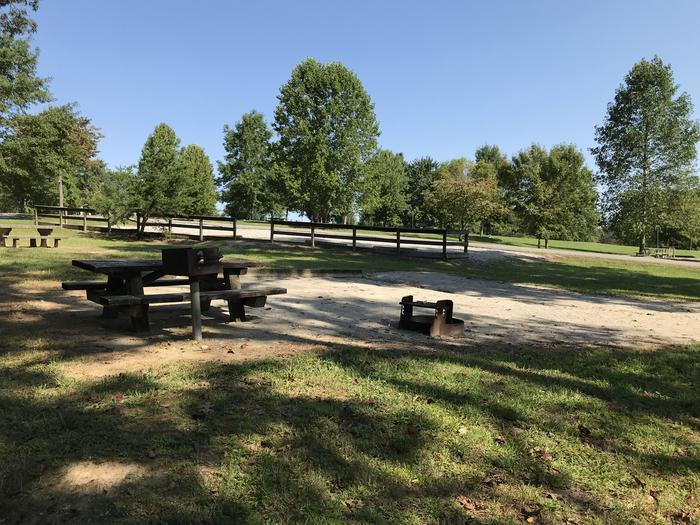 WILLOW GROVE CAMPGROUND SITE #70 TABLE, PEDESTAL GRILL, FIRE RING, PARKING IN BACKGROUNDWILLOW GROVE CAMPGROUND SITE #70