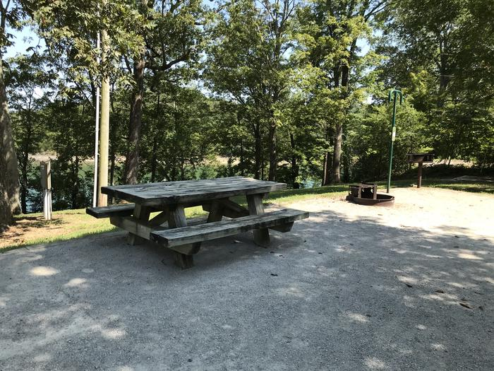 WILLOW GROVE CAMPGROUND SITE #43 WOODEN TABLE IN NARROW LIVING AREAWILLOW GROVE CAMPGROUND SITE #43