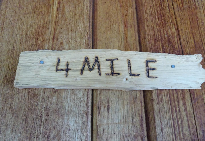 Rustic sign on doorRustic sign on Fourmile Cabin door