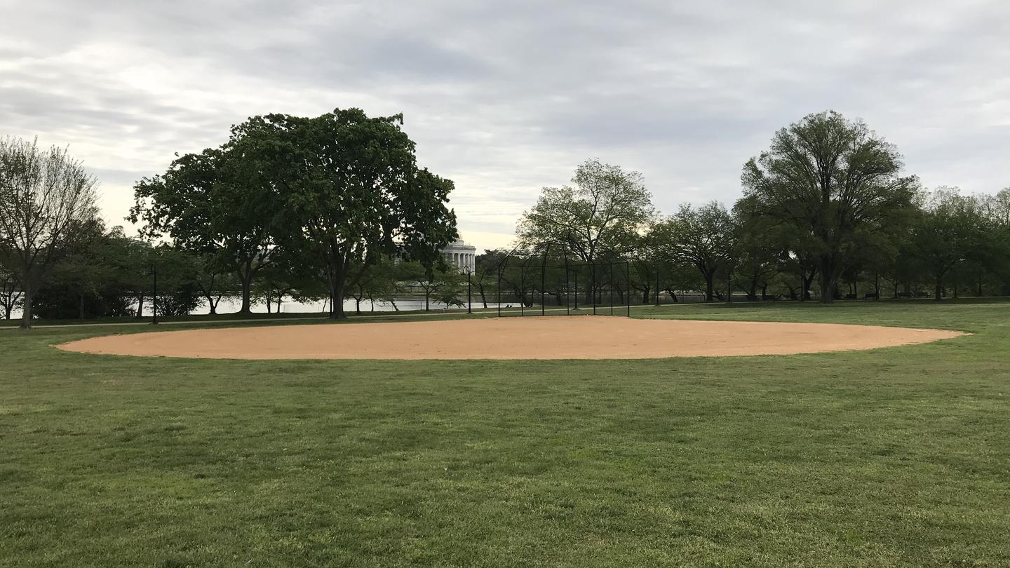 A View of field S1, featuring an an outfield, infield, and backstop, with trees, the Tidal Basin and the Thomas Jefferson Memorial in the background. A View of field S1 with the Tidal Basin and the Thomas Jefferson Memorial in the background.