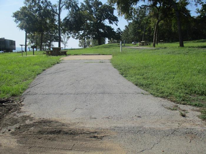 Site 46 - Taylor FerrySite 46 offers an asphalt drive and concrete parking pad.  Shade is limited for this campsite.