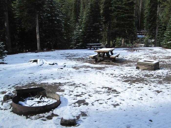 campsite picnic table, fire ring and gray water dump siteOlive Lake Campground site #18
