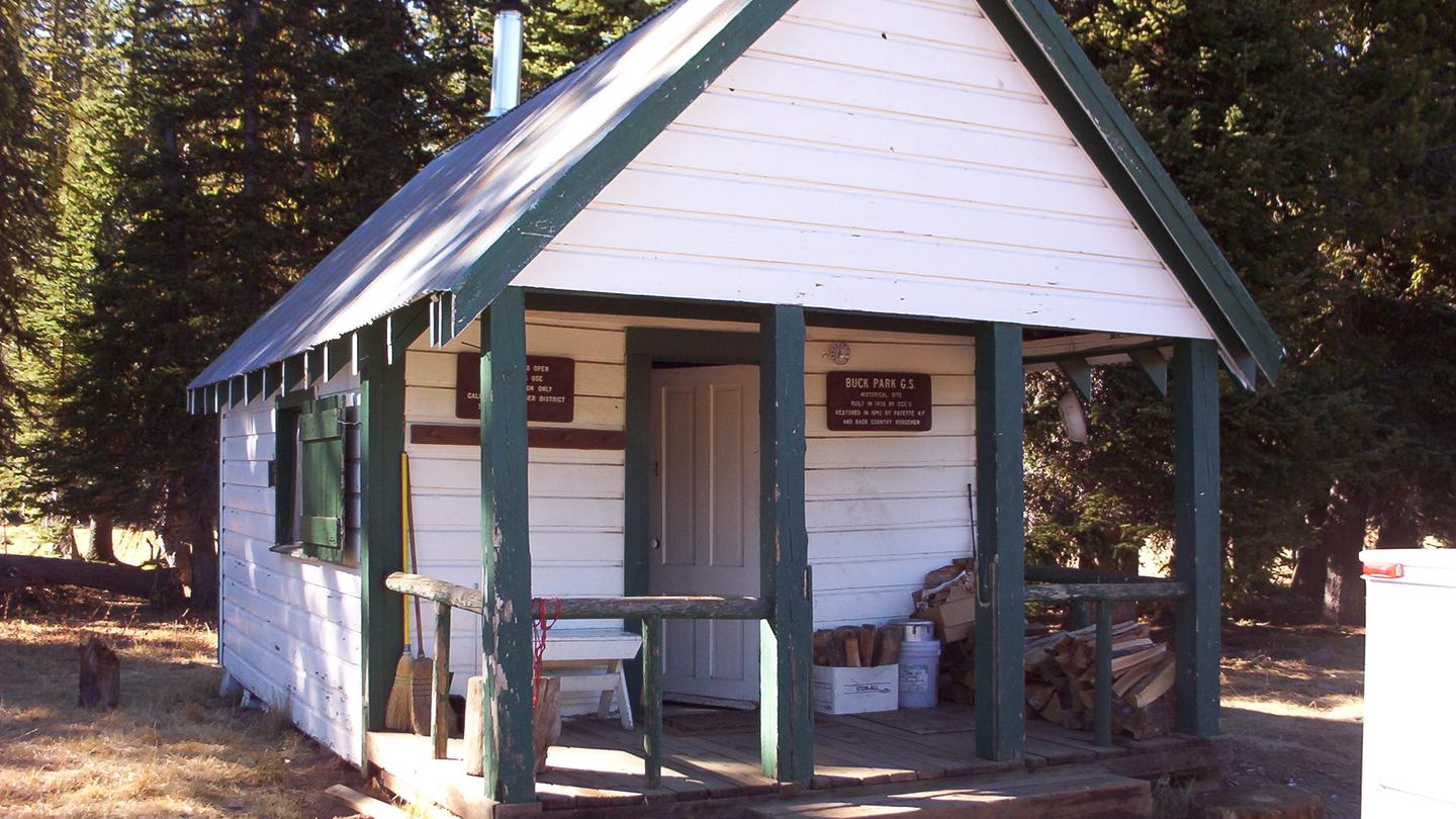 BUCK PARK CABIN - Front of white and green cabinFront of Buck Park Cabin, Payette NF