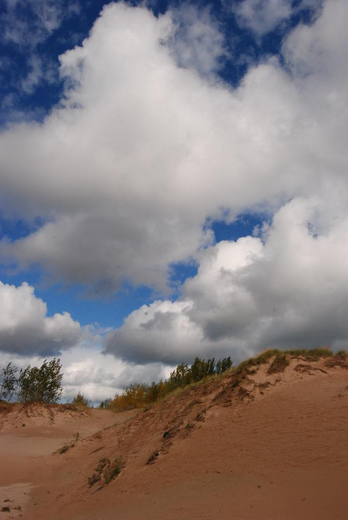 Summer clouds over a sand duneSand and sky meet on the dunes.
