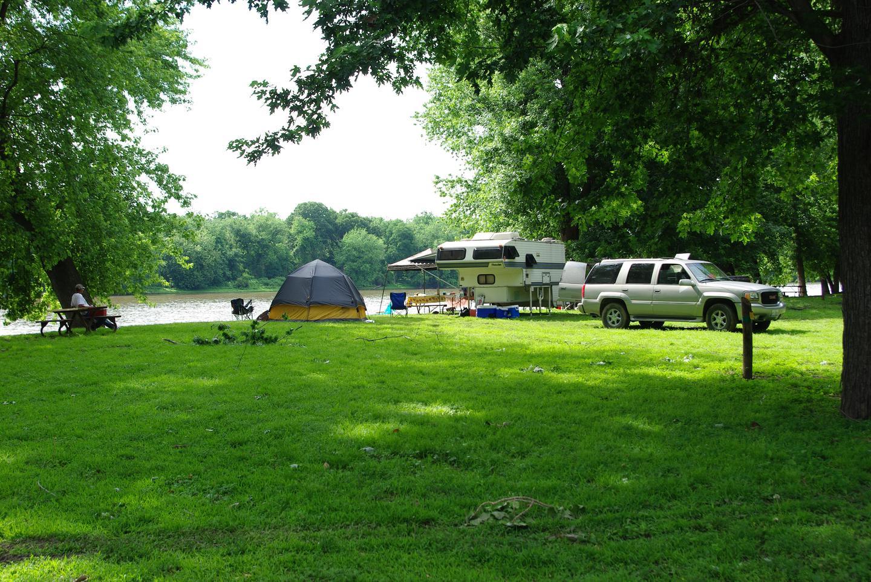 Popup Camper and Tent along river campsite