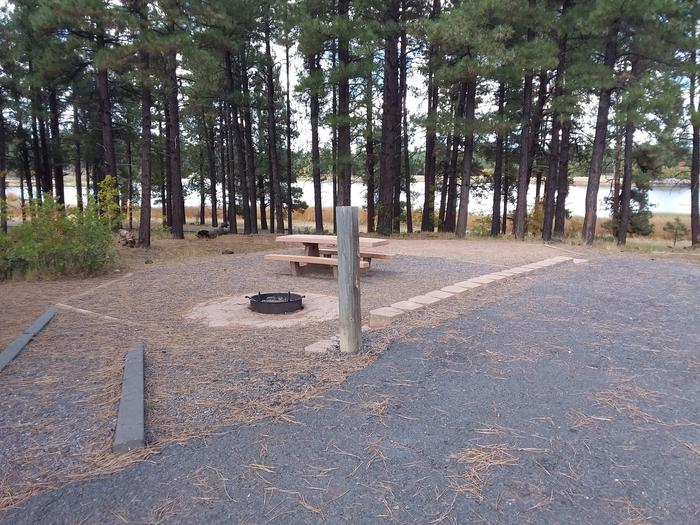Paved/gravel site with lake view in backgroundsite 017