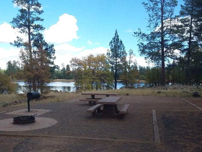 campsite with two picnic tables and a pretty view of the lakesite 027