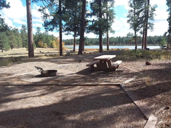 gravel campsite with view of lakesite 062