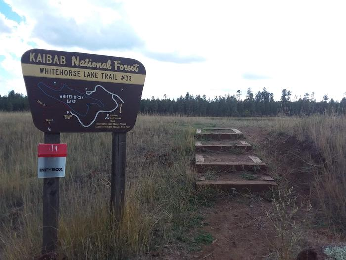 Start of a trail with mapWhitehorse lake trail