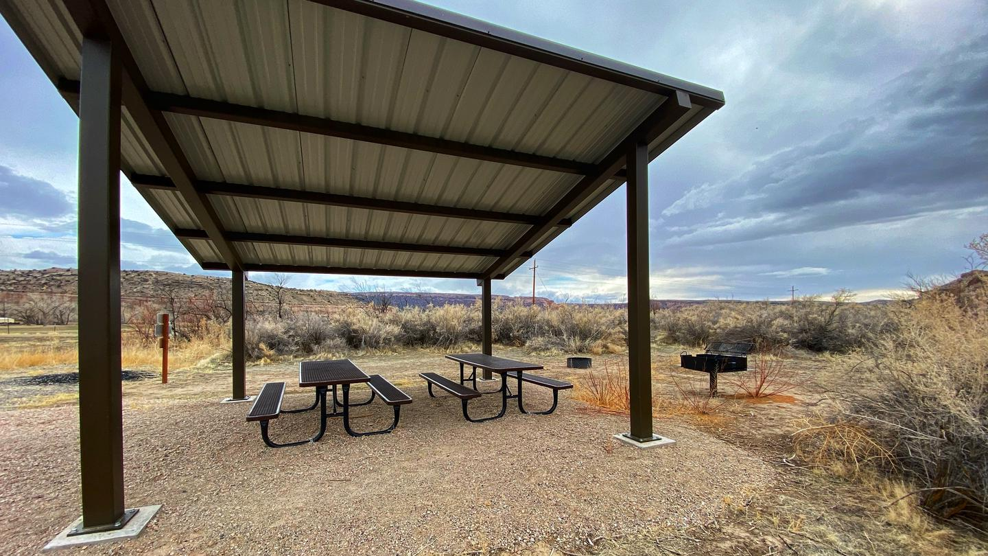 Westwater Group Site picnic tables underneath shade shelter.
