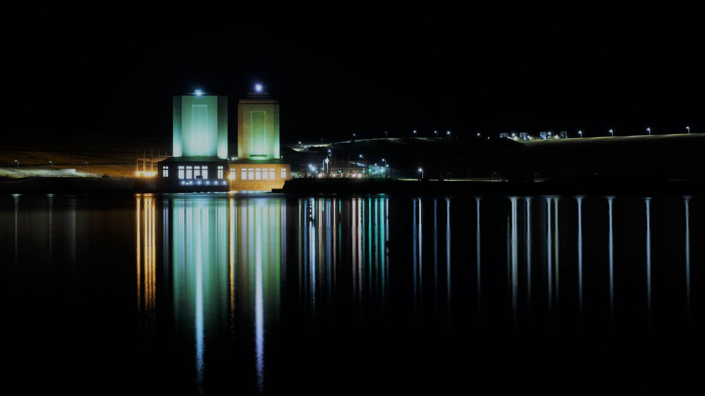 A view of the power houses at night.
