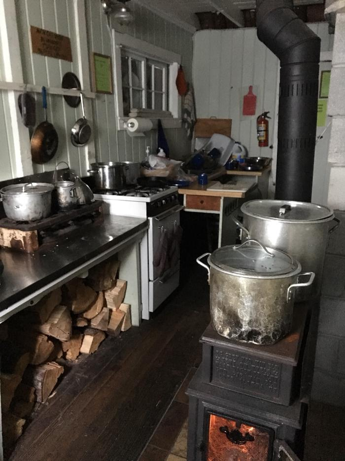 KitchenKitchen is heated by wood stove, with propane oven and 4 burner stove