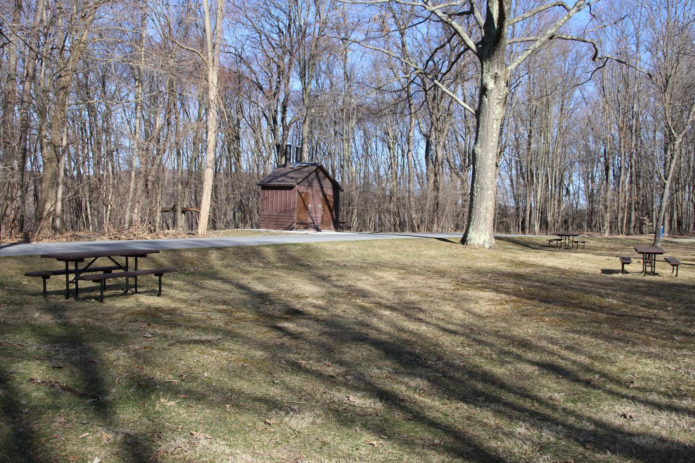 The portalettes near the picnic area.