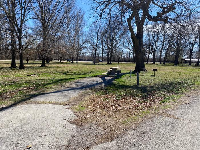 Site 8 - Afton Landing This site is partially shaded with a paved drive/slab. The site comes equipped with a picnic table, grill and a firepit to enjoy while camping.