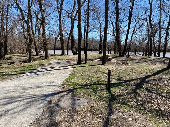 Site 11 - Afton LandingThis site is heavily shaded with a paved drive/slab. The site comes equipped with a picnic table, grill and a firepit to enjoy while camping. Enjoy the view of the river with direct access down to the bank right behind the campsite.