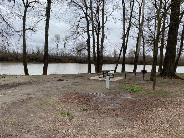 Site 12 - Afton LandingThis site is heavily shaded with a paved drive/slab. The site comes equipped with a picnic table, grill and a firepit to enjoy while camping. Enjoy the view of the river with direct access down to the bank right behind the campsite.