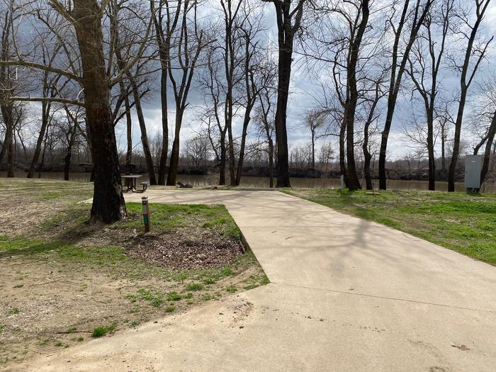 Site 14 - Afton LandingThis site is partially shaded with a paved drive/slab. The site comes equipped with a picnic table, grill and a firepit to enjoy while camping. Enjoy the view of the river with direct access down to the bank right behind the campsite.