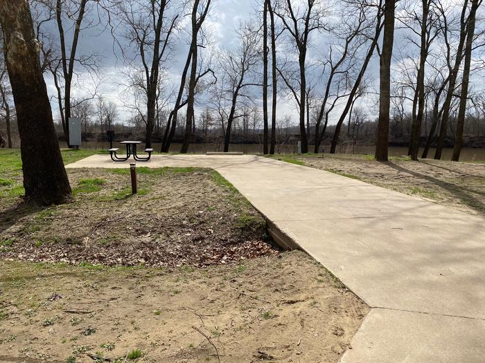 Site 15 - Afton LandingThis site is partially shaded with a paved drive/slab. The site comes equipped with a picnic table, grill and a firepit to enjoy while camping. Enjoy the view of the river with direct access down to the bank right behind the campsite.