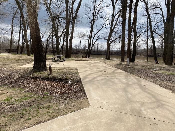Site 16 - Afton LandingThis site is partially shaded with a paved drive/slab. The site comes equipped with a picnic table, grill and a firepit to enjoy while camping. Enjoy the view of the river with direct access down to the bank right behind the campsite.