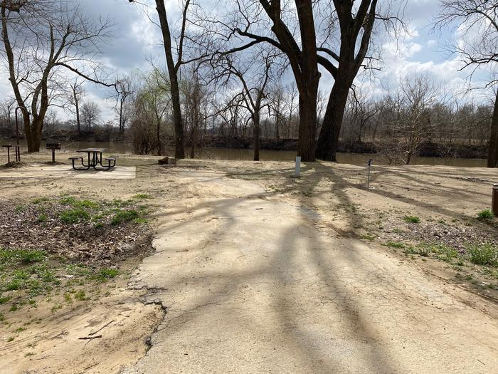 Site 18 - Afton LandingThis site is partially shaded with a paved drive/slab. The site comes equipped with a picnic table, grill and a firepit to enjoy while camping. Enjoy the view of the river with direct access down to the bank right behind the campsite.