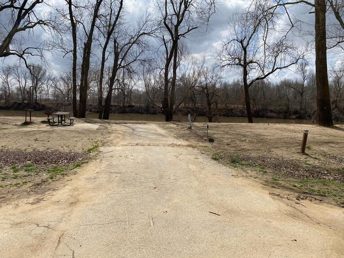 Site 19 - Afton LandingThis site is partially shaded with a paved drive/slab. The site comes equipped with a picnic table, grill and a firepit to enjoy while camping. Enjoy the view of the river with direct access down to the bank right behind the campsite.