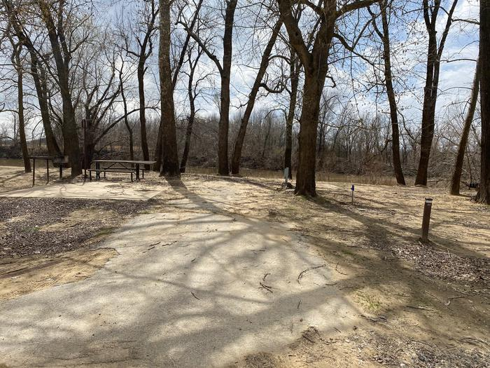 Site 20 - Afton LandingThis site is heavily shaded with a paved drive/slab. The site comes equipped with a picnic table, grill and a firepit to enjoy while camping. Enjoy the view of the river with direct access down to the bank right behind the campsite.