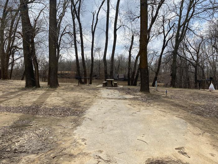 Site 21 - Afton LandingThis site is heavily shaded with a paved drive/slab. The site comes equipped with a picnic table, grill and a firepit to enjoy while camping. Enjoy the view of the river with direct access down to the bank right behind the campsite.
