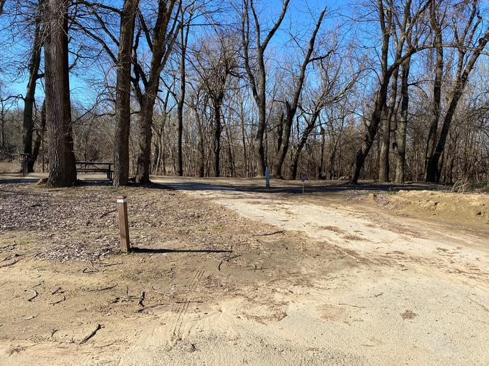 Site 22 - Afton LandingThis site is heavily shaded with a paved drive/slab. The site comes equipped with a picnic table, grill and a firepit to enjoy while camping. Enjoy the view of the river with direct access down to the bank right behind the campsite.