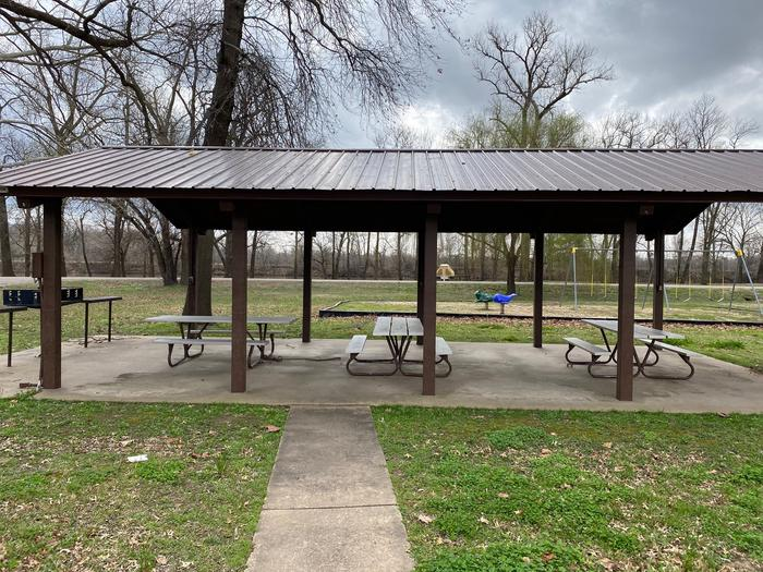 Group ShelterThis Shelter/Pavilion area is the perfect spot to get out of the elements and still enjoy a peaceful gathering. This area does have electric and is equipped with several power outlets, picnic tables and grills to be used.