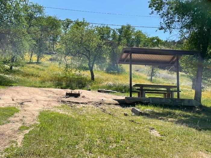 Site 7 Picnic AreaShade shelter, picnic table, and fire ring located above the driveway to Site 7