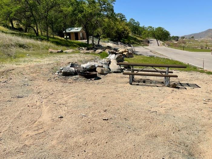 Site 16 picnic areaPicnic table and fire ring above parking area for site 16.