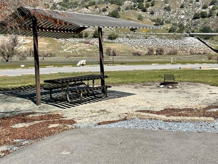 Picnic site for 19.Shade shelter, picnic table, and fire ring.