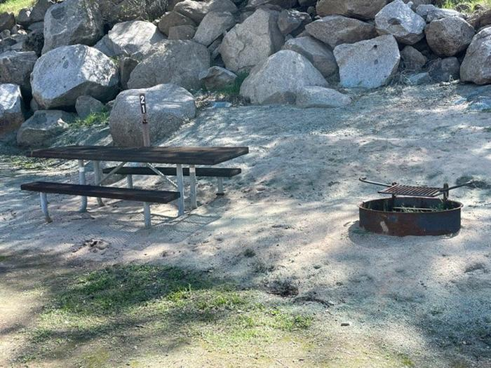 Table and fire ring for site.Picnic table and fire ring for site 21. Tent or very small camping unit only. A family sized tent for 8 will be too big for this site.