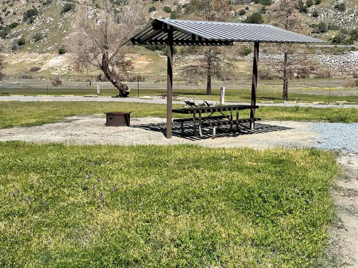 Shade shelter ,table, and fire ring.Shade shelter, fire ring, and picnic table for site.