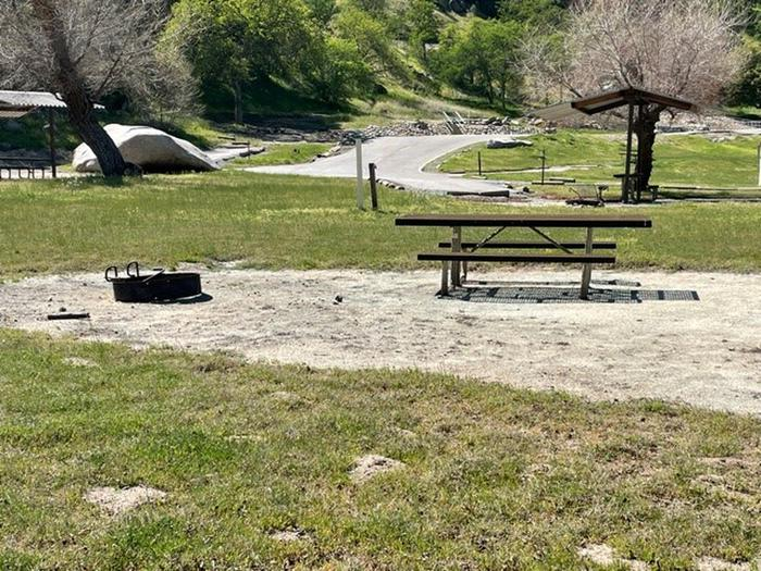 Camping area at site. this is a multi purpose site for Camping units and tents. Picnic table and fire ring at campsite. This site is in an interior circle with four other sites. Four small backpacking tents or one family tent for 8.