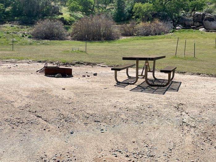 Campsite area.Picnic table and fire ring at campsite.
