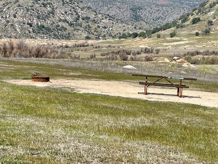 Picnic area.Picnic table and fire ring at campsite.