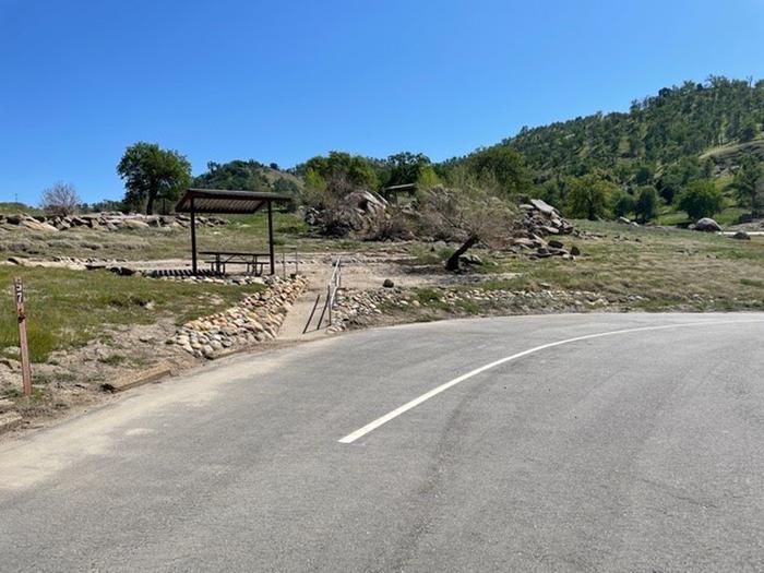 Long roadside pull-through for site.Long roadside pull-through for campsite.