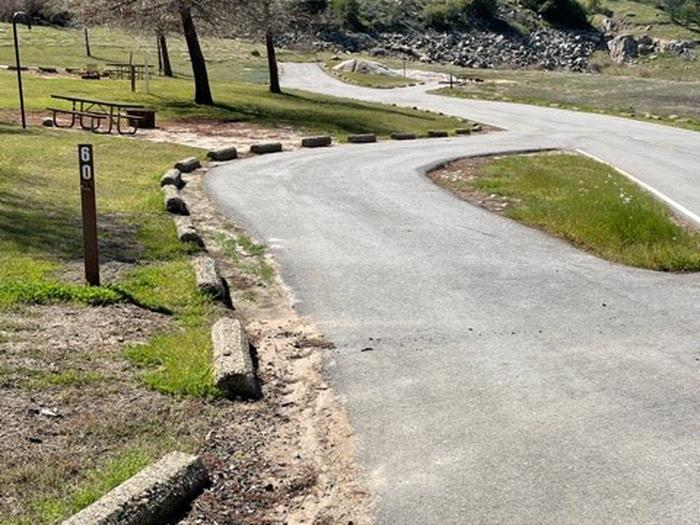 Long pull-through driveway with little to no shade.  Pull-through driveway for long RVs and trailers. Fairly level.