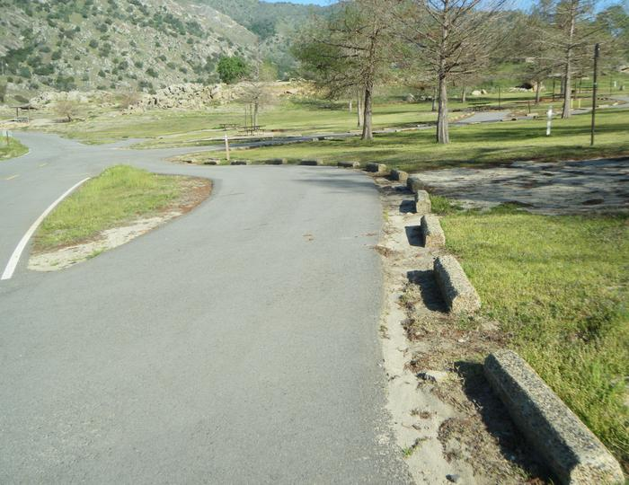 Pull through campsite has seasonal view of Lake Kaweah. Pull through site for long RVs and trailers. Little to no shade.