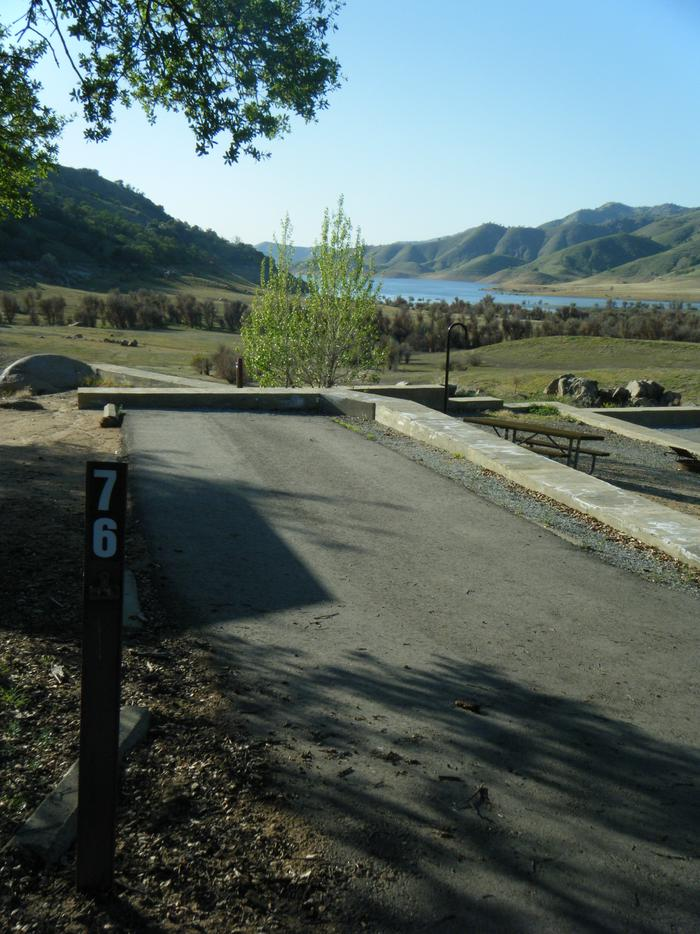 Long back in driveway on a multipurpose site. Can accommodate longer camping units. Longer units tend to pull in rather than back in up a hill. Back in driveway for multipurpose site on a hill. Access road is one way down the hill. Great seasonal views of Lake Kaweah.