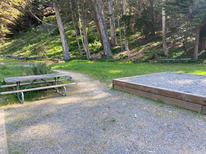 A picnic table and tent pad.Site 3