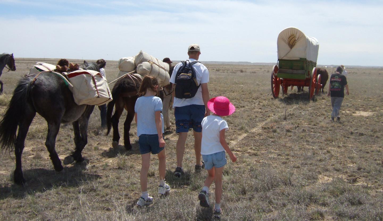Hiking the Santa Fe TrailThe Santa Fe Trail Encampment features a hike with the fort's wagon down the original Santa Fe Trail.